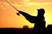 10634382-fisherman-silhouette-at-sunset