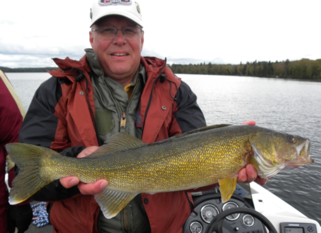 Mike Turner - Davenport, IA with a HUGH Walleye beauty caught in September on Wawang.
